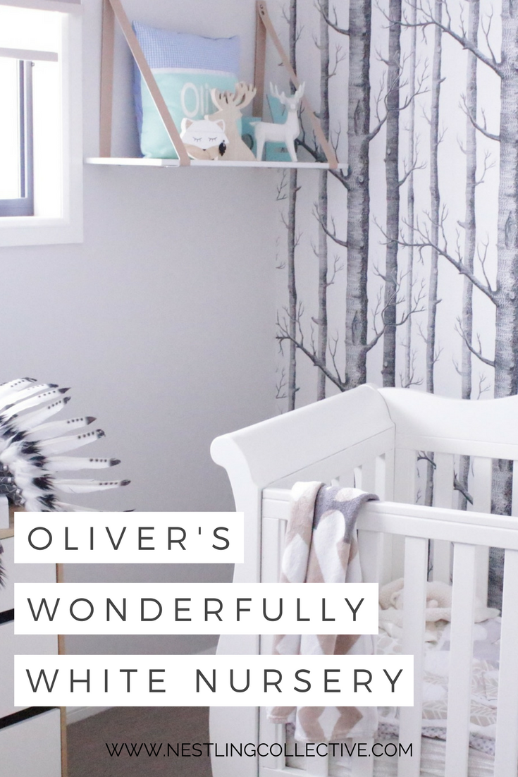 Take a peek into this beautiful wood and white nursery created for little Oliver. Along with the clean lines and neutral accents, we're SO in love with the stunning birch tree feature wall! White Nursery | Neutral Nursery | Nursery Baby Boy