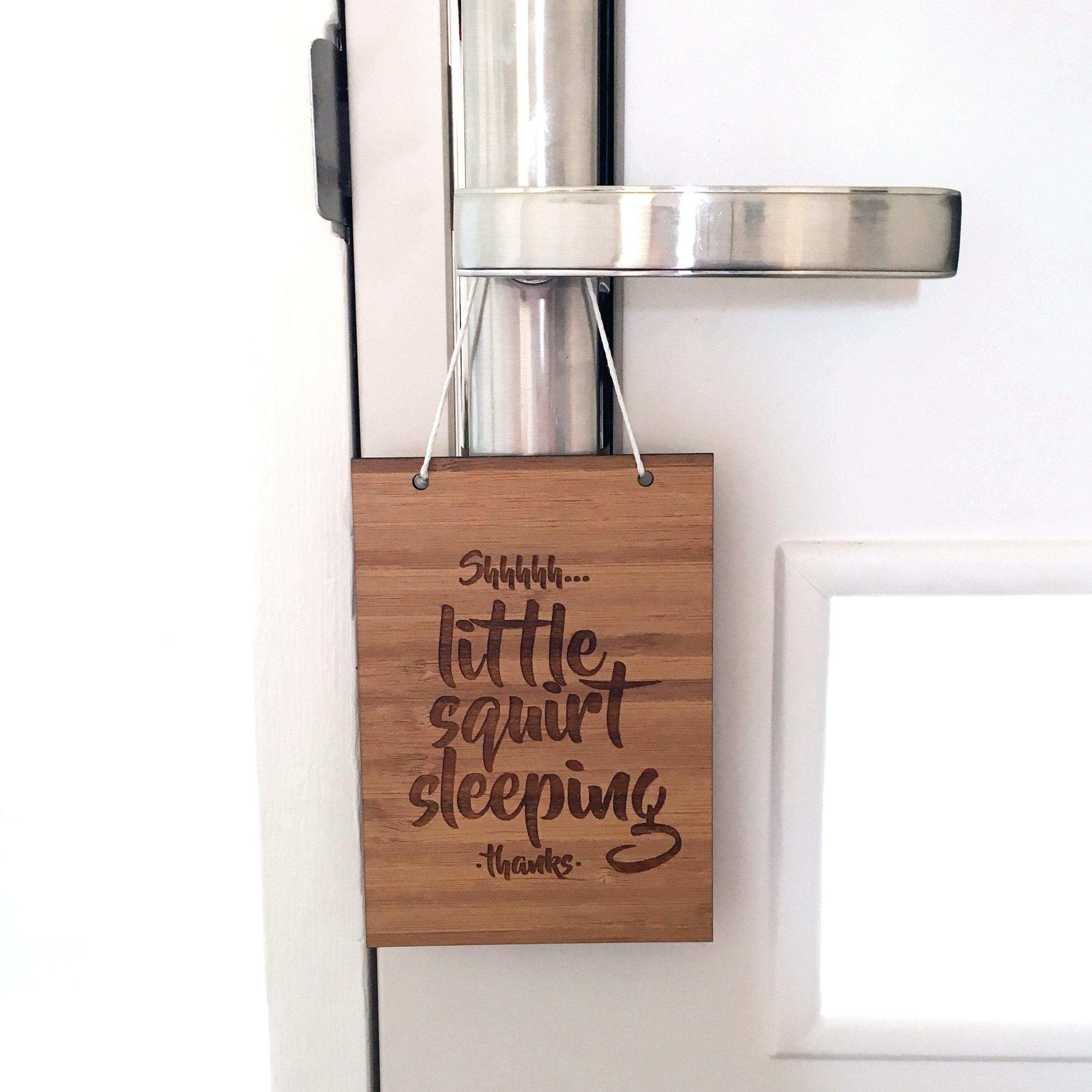 Alma Custom Designs | Little Squirt Sleeping Door Hanger $22 | www.nestlingcollective.com